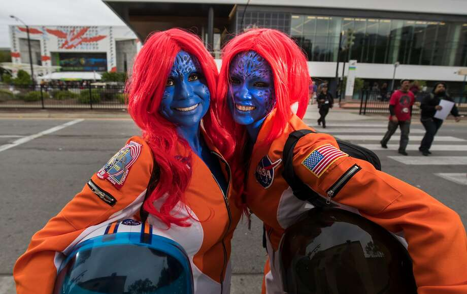 """Cyndi Norman and Femy McGrath, both of San Jose, call themselves """"Mystique in Space"""" at Silicon Valley Comic Con on Saturday, April 22, 2017 in San Jose , CA.  They both work at NASA. Photo: Paul Kuroda, Special To The Chronicle"""