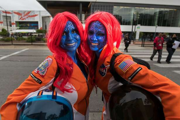 """Cyndi Norman and Femy McGrath, both of San Jose, call themselves """"Mystique in Space"""" at Santa Clara Comic Con on Saturday, April 22, 2017 in San Jose , CA.  They both work at NASA."""
