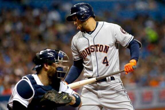 ST. PETERSBURG, FL - APRIL 21:  George Springer #4 of the Houston Astros reacts after striking out swinging in front of catcher Derek Norris #33 of the Tampa Bay Rays during the first inning of a game on April 21, 2017 at Tropicana Field in St. Petersburg, Florida. (Photo by Brian Blanco/Getty Images)