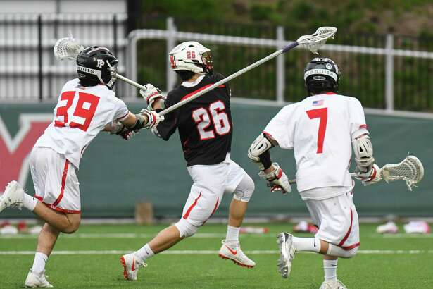 Ryan O'Connell (26) of the New Canaan Rams shoots during a game against the Fairfield Prep Jesuits at Fairfield University on April 22, 2017 in Fairfield, Connecticut.