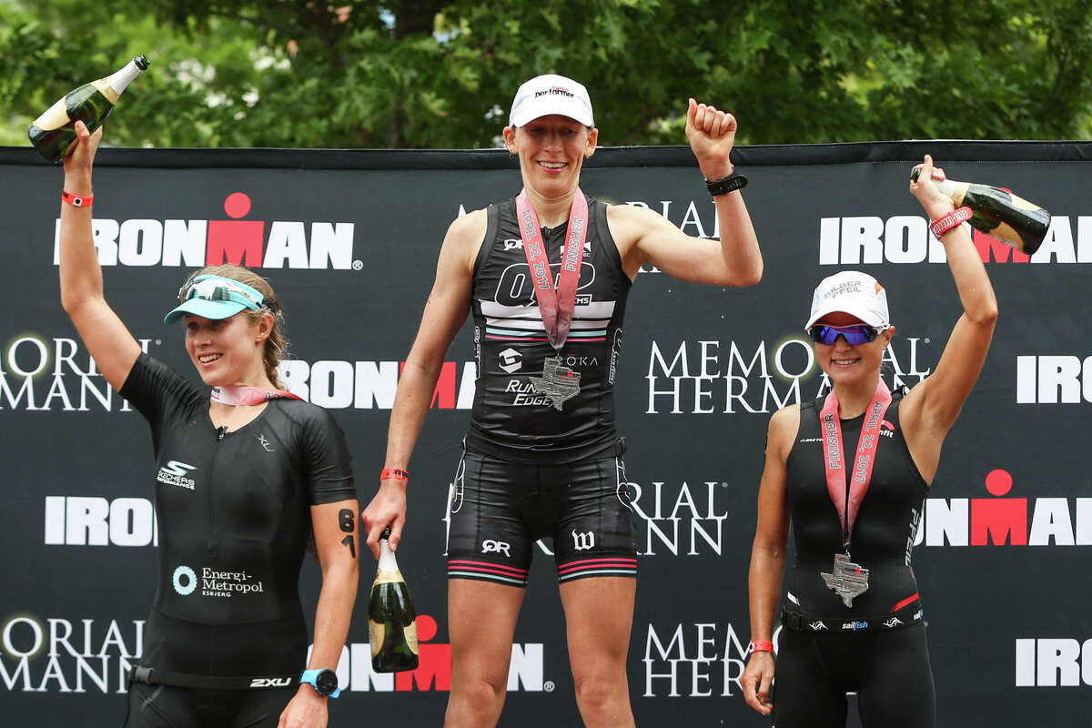 From the left: Maja Stage-Nielsen, of Denmark, Jodie Robertson, of New York, and Michaela Herlbauer, of Austria, celebrate at the awards podium during the Memorial Hermann IRONMAN North American Championship Texas on Saturday, April 22, 2017, in The Woodlands.