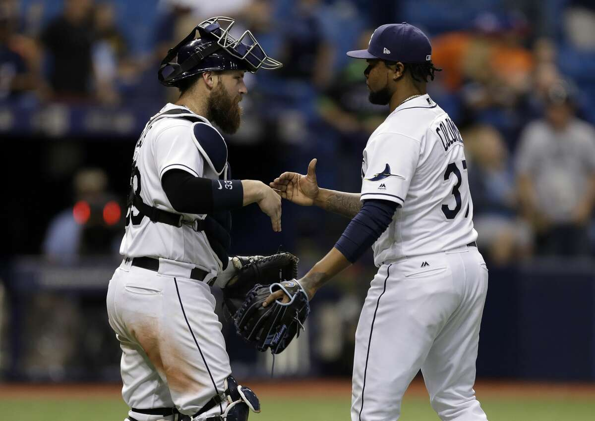 Tampa Bay Rays relief pitcher Alex Colome and catcher Derek Norris celebrate after the Rays defeated the Houston Astros 6-3 during a baseball game Saturday, April 22, 2017, in St. Petersburg, Fla. (AP Photo/Chris O'Meara)