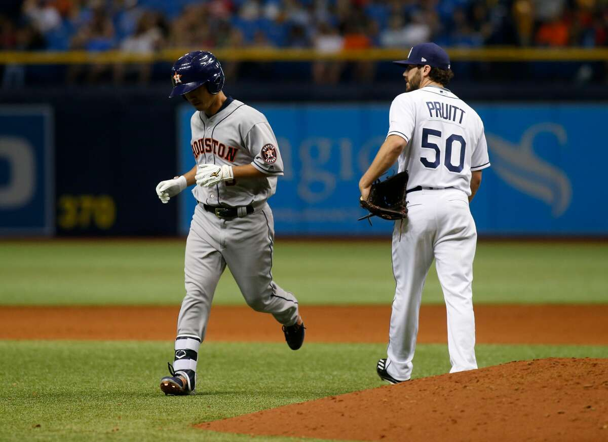 ST. PETERSBURG, FL - APRIL 22: Norichika Aoki #3 of the Houston Astros runs by pitcher Austin Pruitt #50 of the Tampa Bay Rays as he makes his way back to the dugout after lining out to left field during the eighth inning of a game on April 22, 2017 at Tropicana Field in St. Petersburg, Florida. (Photo by Brian Blanco/Getty Images)