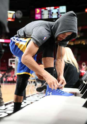 quality design 4e721 d4931 2of17FILE-- Golden State Warriors  Stephen Curry ties his shoe prior to  warming up before Warriors play Portland Trail Blazers in Game 3 of NBA  Western ...