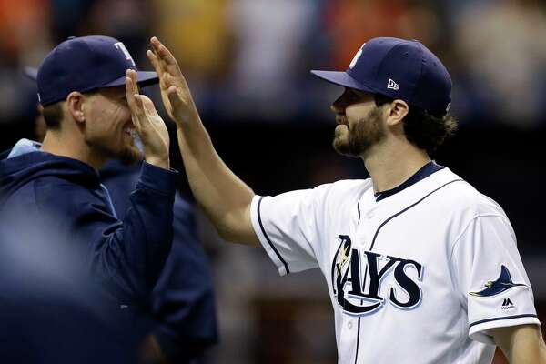 Tampa Bay Rays relief pitcher Austin Pruitt, right, high fives teammates after the Rays defeated the Houston Astros 6-3 during a baseball game Saturday, April 22, 2017, in St. Petersburg, Fla. (AP Photo/Chris O'Meara)