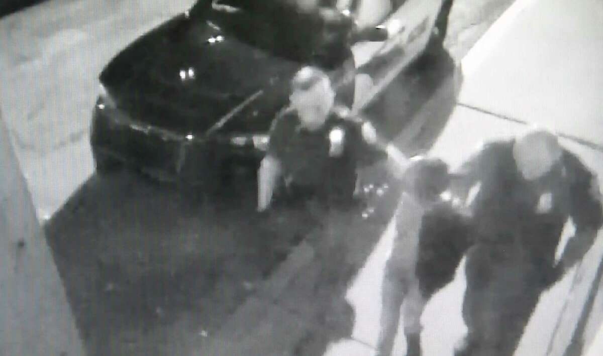 Video screen grab from the Schenectady Police Station showing Vebra Moore being taken into the station in October 2015. Minutes later she was knocked unconscious and her head was split open. Police said two officers used appropriate force because Moore, who was handcuffed behind her back, allegedly bit an officer's finger.