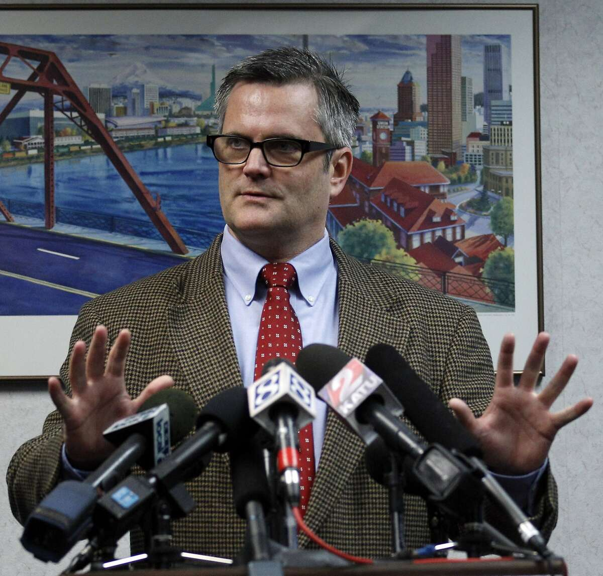 In this photo taken Nov. 14, 2011, Portland Mayor Sam Adams discuss Sunday's police raid on the Occupy Portland encampment in two downtown parks during a news conference, in Portland, Ore. As concerns over safety and sanitation grew at the encampments over the last month, officials from nearly 40 cities turned to each other on conference calls, sharing what worked and what hasn't as they grappled with the leaderless movement. (AP Photo/Rick Bowmer)