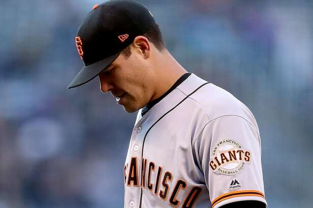 DENVER, CO - APRIL 22:  Starting pitcher Matt Moore #45 of the San Francisco Giants walks off the field after giving up three runs in the first inning to the Colorado Rockies at Coors Field on April 22, 2017 in Denver, Colorado.  (Photo by Matthew Stockman/Getty Images)