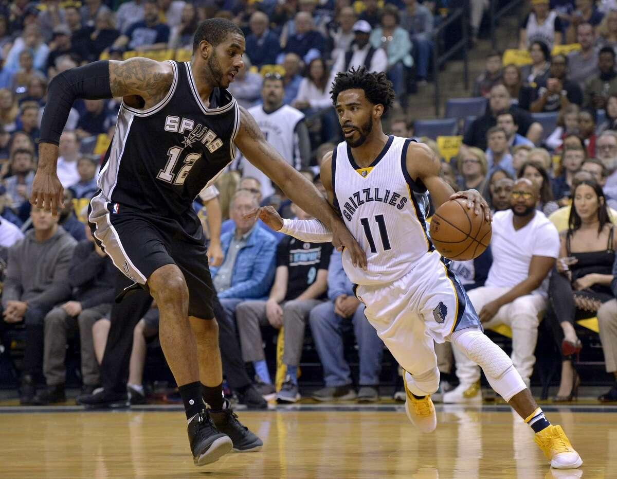 Memphis Grizzlies guard Mike Conley (11) drives against San Antonio Spurs forward LaMarcus Aldridge (12) during the first half of Game 4 in an NBA basketball first-round playoff series Saturday, April 22, 2017, in Memphis, Tenn. (AP Photo/Brandon Dill)