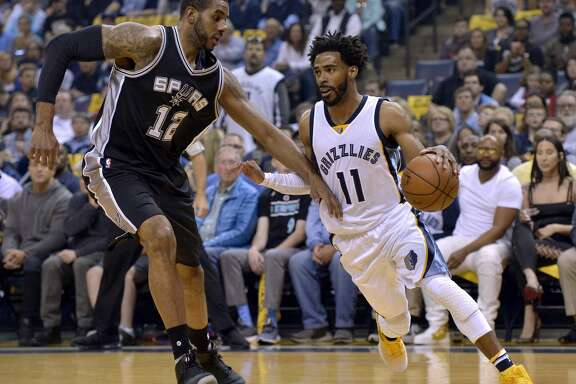Memphis Grizzlies guard Mike Conley (11) drives against San Antonio Spurs forward LaMarcus Aldridge (12) during the first half of Game 4 in an NBA basketball first-round playoff series Saturday, April 22, 2017, in Memphis, Tenn. (AP Photo/Brandon Dill)