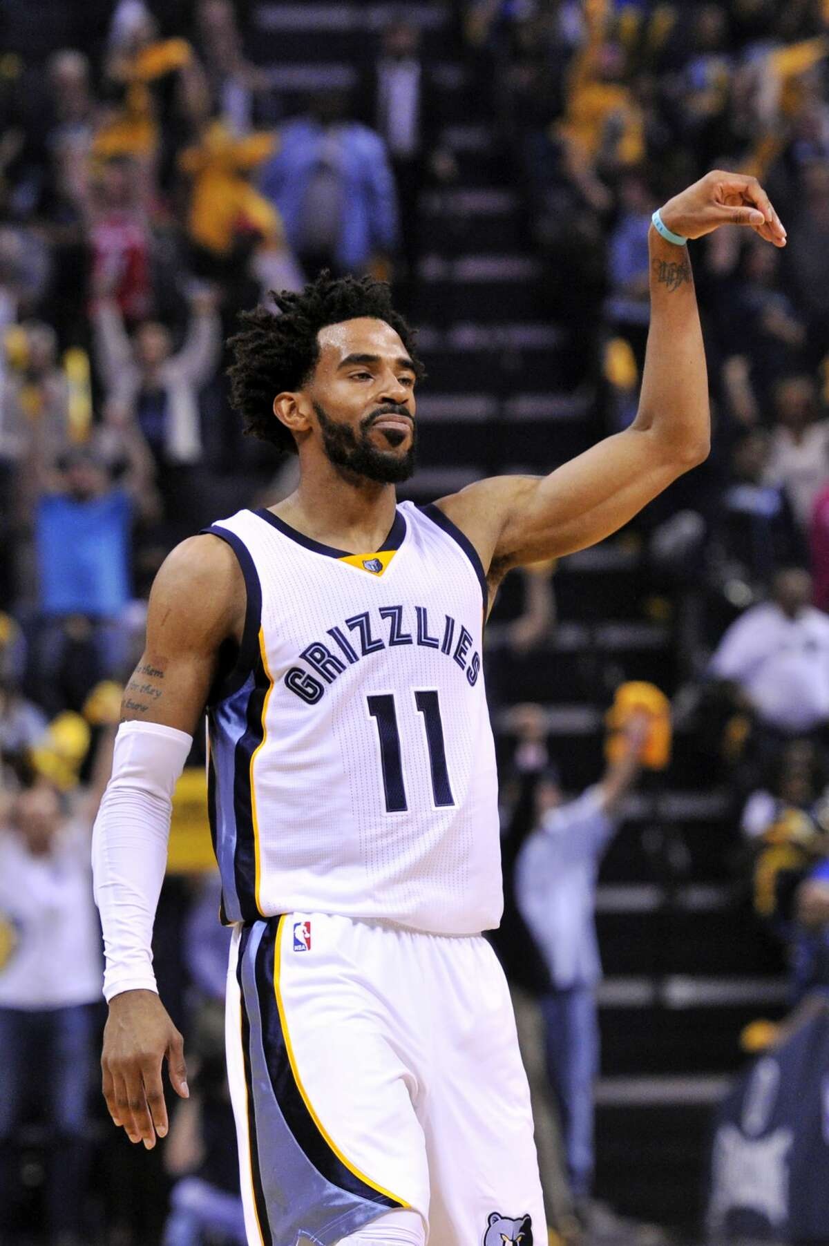 Memphis Grizzlies guard Mike Conley (11) reacts after scoring a three-point basket during the first half of Game 4 in an NBA basketball first-round playoff series against the San Antonio Spurs, Saturday, April 22, 2017, in Memphis, Tenn. (AP Photo/Brandon Dill)