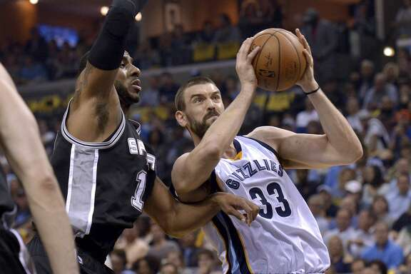 Memphis Grizzlies center Marc Gasol (33) drives against San Antonio Spurs forward LaMarcus Aldridge, left, during the first half of Game 4 in an NBA basketball first-round playoff series Saturday, April 22, 2017, in Memphis, Tenn. (AP Photo/Brandon Dill)