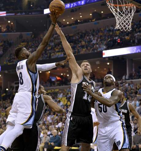 Memphis Grizzlies forward James Ennis (8) shoots against San Antonio Spurs forwards Kawhi Leonard, second from left, and David Lee (10) as Grizzlies forward Zach Randolph (50) moves for position during the first half of Game 4 in an NBA basketball first-round playoff series Saturday, April 22, 2017, in Memphis, Tenn. (AP Photo/Brandon Dill) Photo: Brandon Dill/Associated Press
