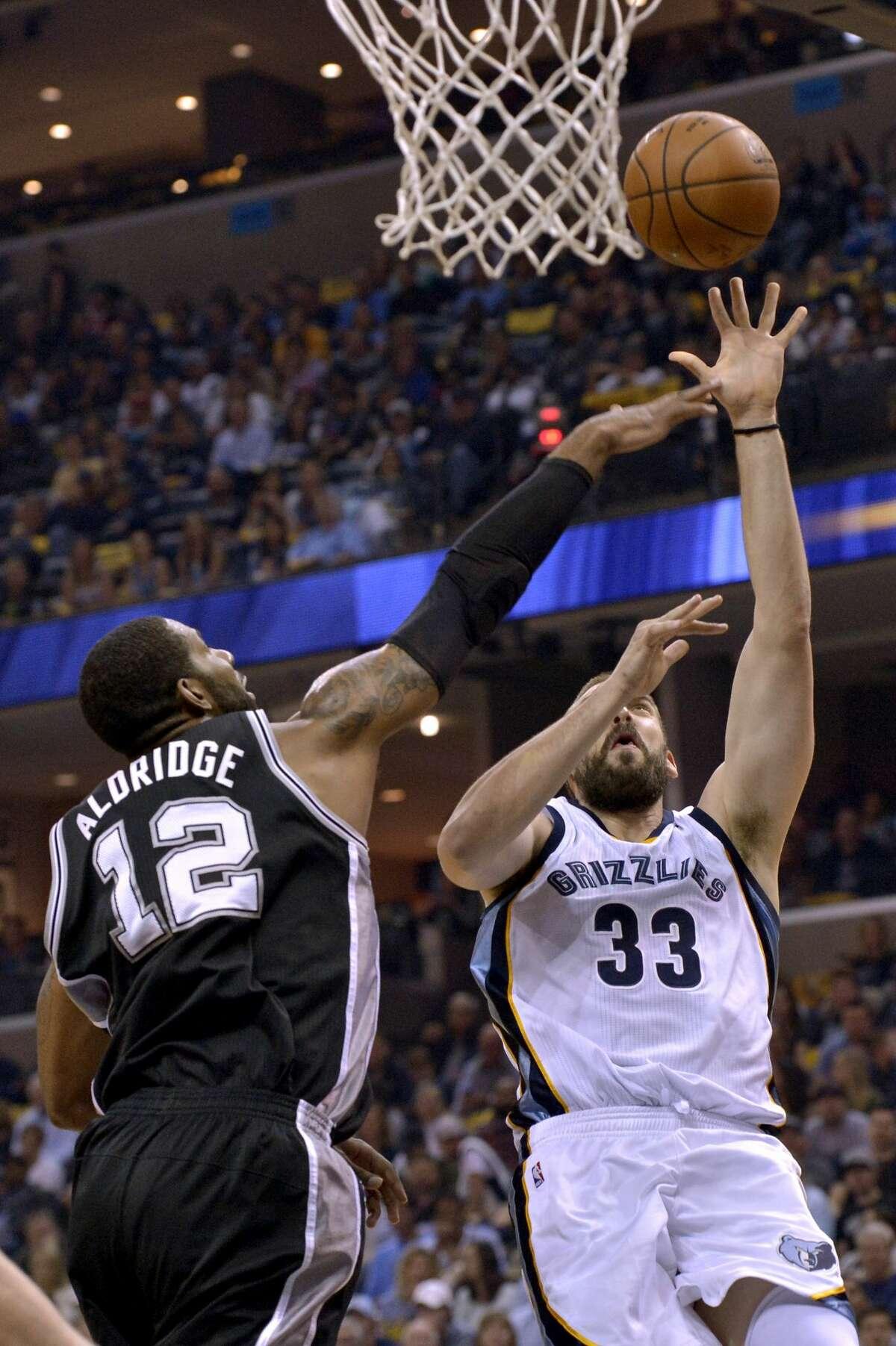 Memphis Grizzlies center Marc Gasol (33) shoots against San Antonio Spurs forward LaMarcus Aldridge (12) during the first half of Game 4 in an NBA basketball first-round playoff series Saturday, April 22, 2017, in Memphis, Tenn. (AP Photo/Brandon Dill)