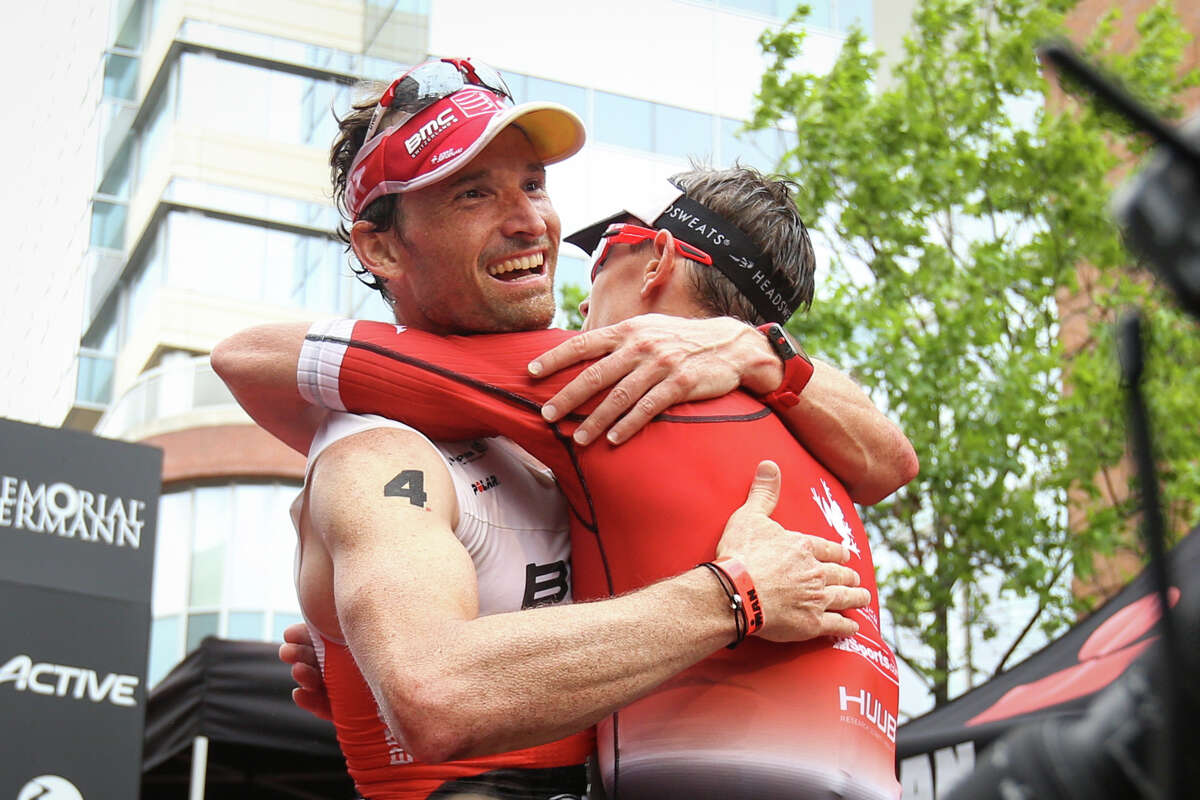 Second place finisher Ronnie Schildknecht, of Switzerland, and first place finisher Matt Hanson, of Iowa, hug at the finish line during the Memorial Hermann IRONMAN North American Championship Texas on Saturday, April 22, 2017, in The Woodlands.