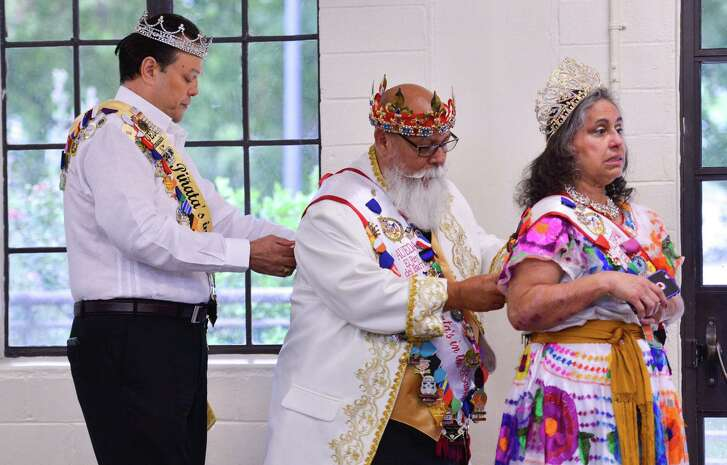 Getting ready for Saturday's Celebrations of Traditions Pow Wow is (left to right) Paul Martinez, Steve Duran, and his wife Virginia. The pow wow, and official Fiesta evvent, was at the Woodlawn gym and celebrates tribal traditions, culture, and opportunity.