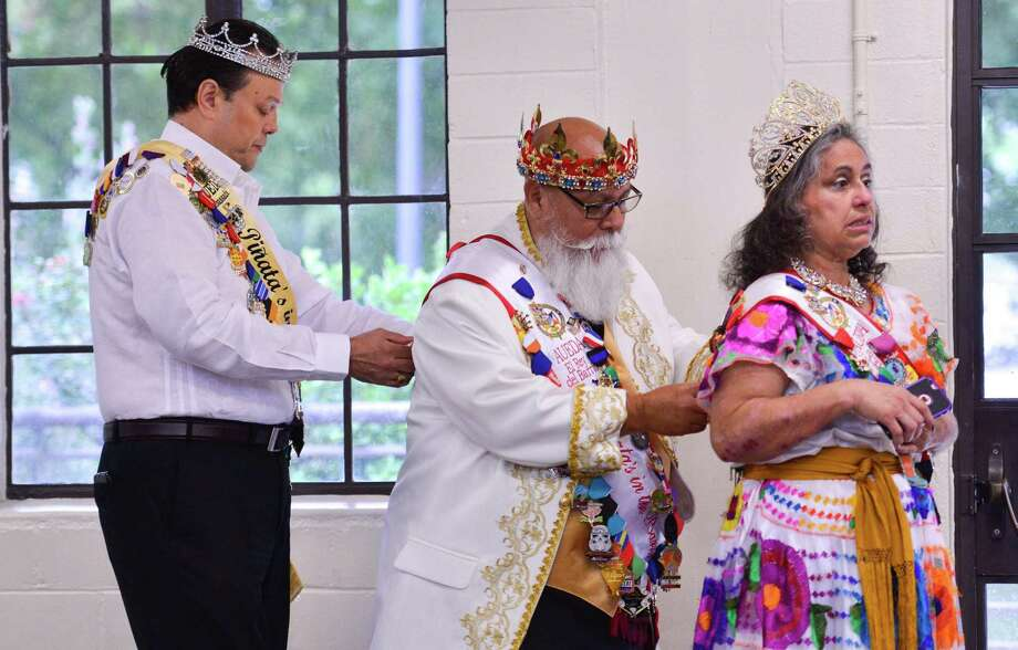 Getting ready for Saturday's Celebrations of Traditions Pow Wow is (left to right) Paul Martinez, Steve Duran, and his wife Virginia. The pow wow, and official Fiesta evvent, was at the Woodlawn gym and celebrates tribal traditions, culture, and opportunity. Photo: Robin Jerstad, Freelance / San Antonio Express News
