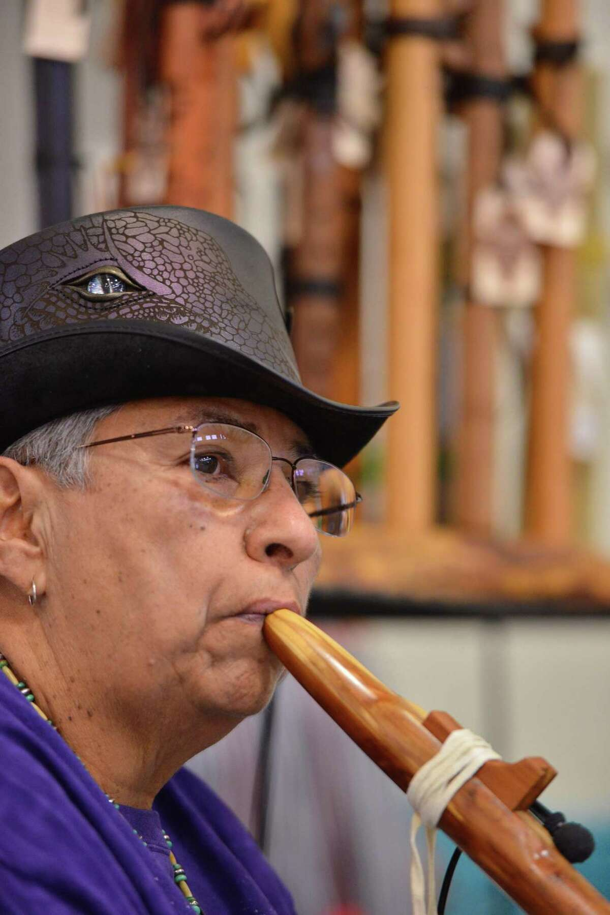 Virgie Raven Hawk, plays a native American flute during the Celebrations of Traditions Pow Wow at the Woodlawn Gym Saturday.The pow wow, an official Fiesta event, celebrates tribal traditions, culture, and opportunity.
