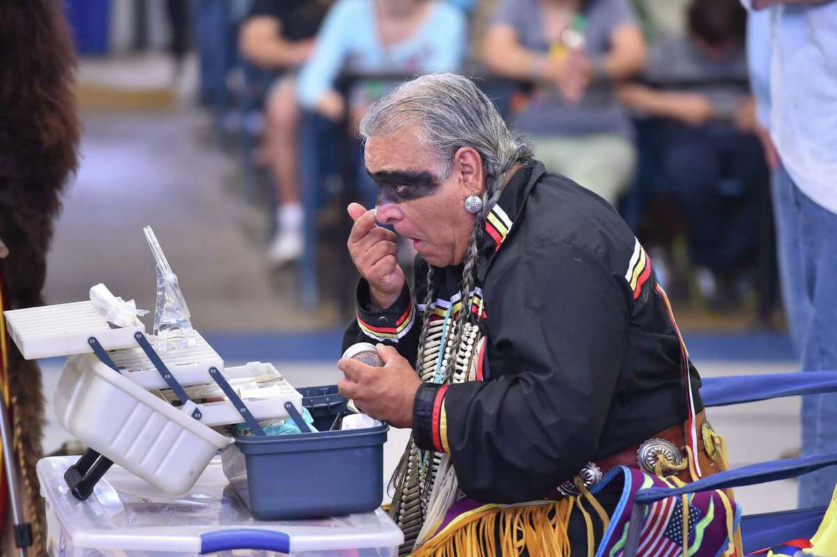 Isaac Cardenas applies traditional make-up prior to the Celebration of Tradions Pow wow at the woodlawn Gym Saturday. the pow wow, which is an official Fiesta event, promotes tribal traditions, culture, and opportunity for native people.