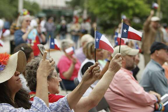 A toast to Freedom was given by raising the Flags. Texans are still celebrating their Independence 181 years after the Battle of San Jacinto. The Daughters of the Republic of Texas Alamo Heroes Chapter, celebrate the victory at the Alamo Cenotaph in front of the Alamo in song and dance on Saturday, April 22, 2017.
