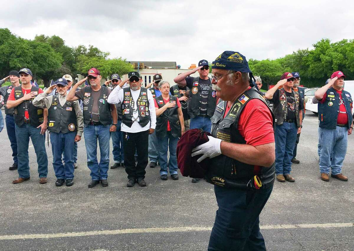 Richard Beumer, a Vietnam veteran, carries the cremains of one of several military veterans who were transported from Amarillo to San Antonio for burial at Fort Sam Houston National Cemetery.