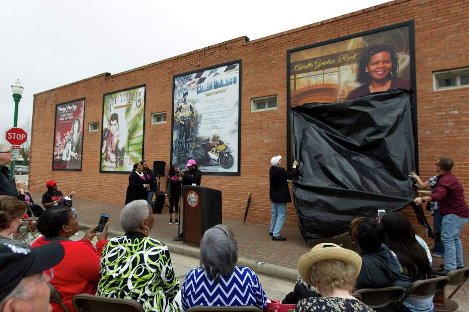 A mural in honor of Annette Gordon-Reed is unveiled at North Main Street and Metcalf Street, Saturday, April 22, 2017, in Conroe. The fourth addition to the Conroe Legends mural wall honored the 1977 graduate of Conroe High School and winner of the 2009 Pulitzer Prize in History. Gordon-Reed was one of the first black students to attend a desegregated school, Anderson Elementary, in Conroe ISD after first attending kindergarten in the then-segregated Booker T. Washington school. Photo: Jason Fochtman, Staff Photographer / © 2017 Houston Chronicle