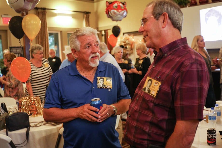 Alumni and veterans William Robinson, left, and Mike Singleton, right, mingle during Conroe High School class of 1967's 50th anniversary reunion on Saturday, April 22, 2017, at Conroe Country Club. Photo: Michael Minasi, Staff Photographer / © 2017 Houston Chronicle