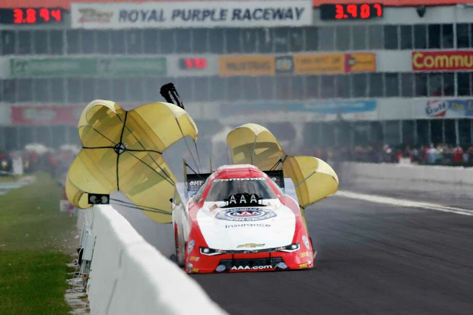 Funny Car driver Robert Hight got a little too close to the wall toward the end of his qualifying run Saturday. He is fourth heading into today's final eliminations. Photo: Tim Warner, Freelance / Houston Chronicle