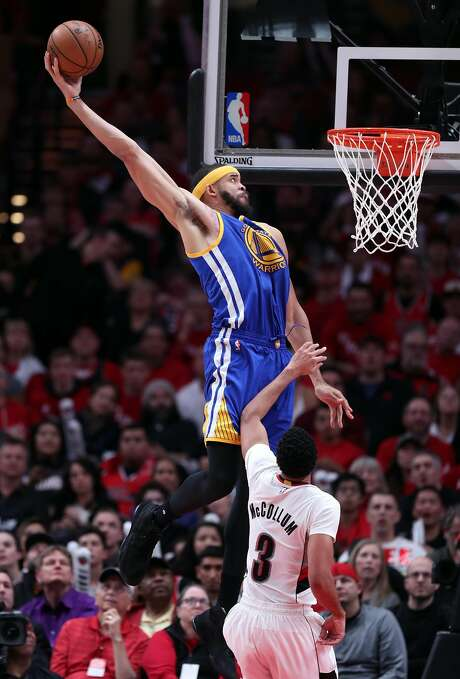 Golden State Warriors' JaVale McGee dunks in 3rd quarter against Portland Trail Blazers' C.J. McCollum in Game 3 of NBA Western Conference 1st Round Playoffs at Moda Center in Portland, Oregon on Saturday, April 22, 2017. Photo: Scott Strazzante, The Chronicle