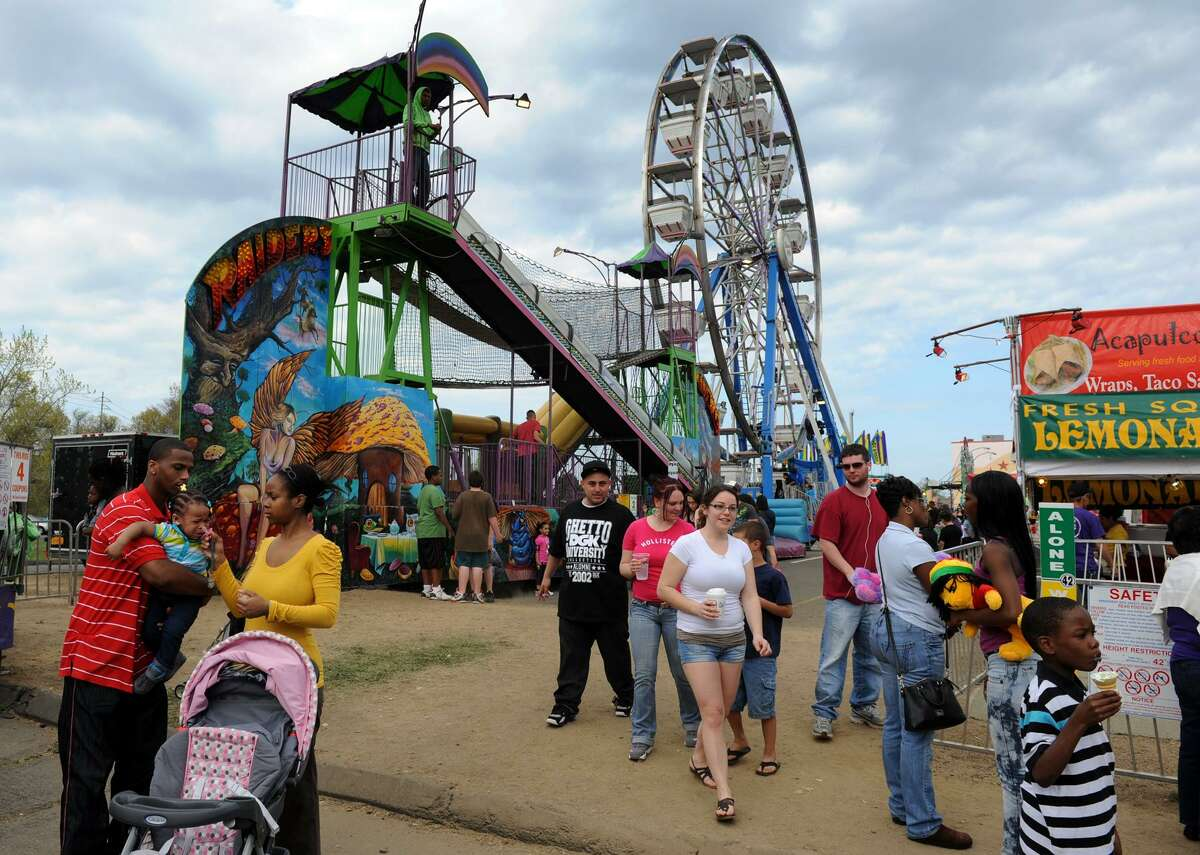 A carnival held at Stratford Square Mall in Stratford, Conn., draws visitors. Malls are using their parking lots to lure visitors with experiences that can't be replicated online - and then get them inside the properties to spend some money.