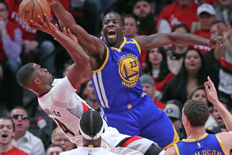 Golden State Warriors' Draymond Green defends against Portland Trail Blazers' Maurice Harkless in 1st quarter in Game 3 of NBA Western Conference 1st Round Playoffs at Moda Center in Portland, Oregon on Saturday, April 22, 2017.