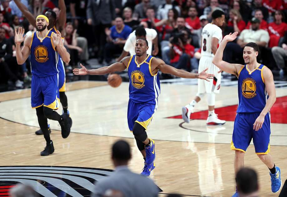 Golden State Warriors' JaVale McGee, Andre Iguodala and Klay Thompson celebrate an Iguodala basket in 4th quarter of 119-113 win over Portland Trail Blazers in Game 3 of NBA Western Conference 1st Round Playoffs at Moda Center in Portland, Oregon on Saturday, April 22, 2017. Photo: Scott Strazzante, The Chronicle
