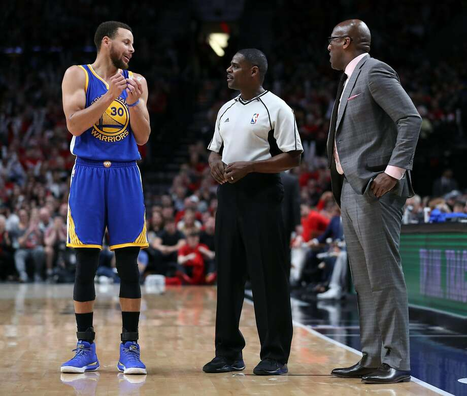 Golden State Warriors' Stephen Curry and Mike Brown confer with official in 3rd quarter of Warriors' 119-113 win over Portland Trail Blazers in Game 3 of NBA Western Conference 1st Round Playoffs at Moda Center in Portland, Oregon on Saturday, April 22, 2017. Photo: Scott Strazzante, The Chronicle