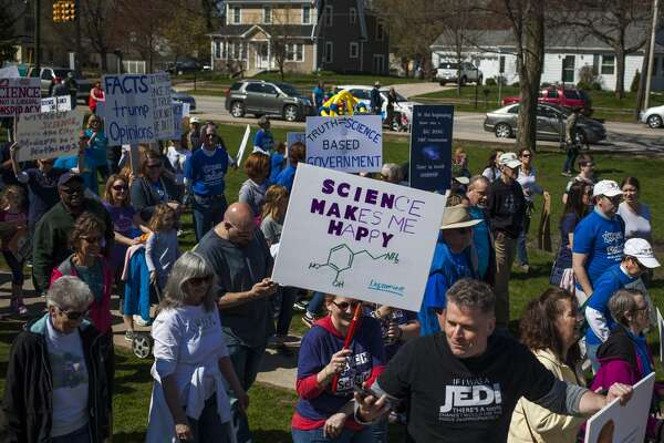 Marchers make their way to Ashman Street at the start of the satellite March for Science in Midland Saturday afternoon. The march in Midland was one of about 425 others across the world associated with the national event.
