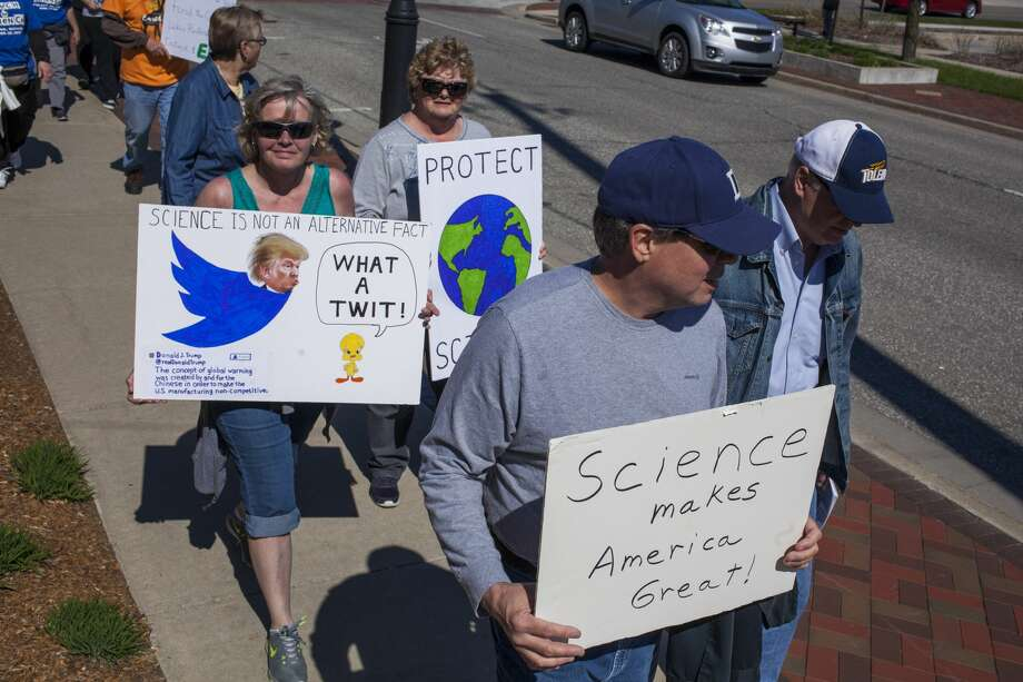 Marchers make their way along Ashman Street during the satellite March for Science in Midland Saturday afternoon. The march in Midland was one of about 425 others across the world associated with the national event. Photo: Josie Norris/Midland Daily News