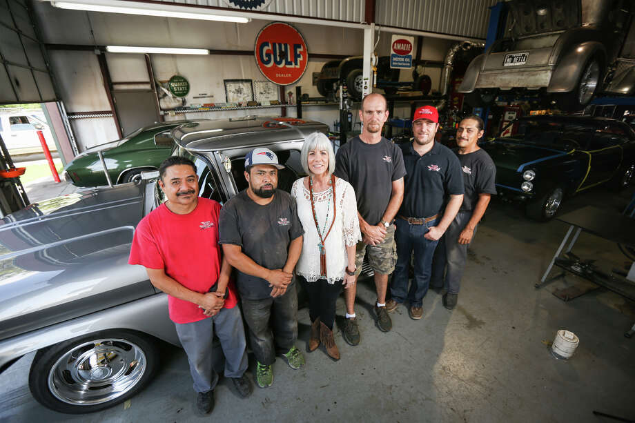 Owner Ann Henry poses for a portrait in front of her restored 1962 Chevy Stepside Pickup with the restoration team from Mo' Muscle Cars on Friday, April 21, 2017. Photo: Michael Minasi, Staff Photographer / © 2017 Houston Chronicle