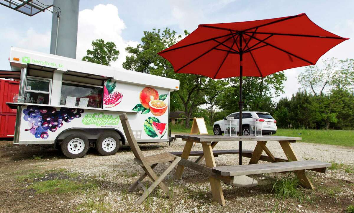 Rafael Michel and Atenas Ascencio run Berry Fresh that specializes in making smoothies, juices and fruit bowls out of a small trailer off FM 2978 in Magnolia.