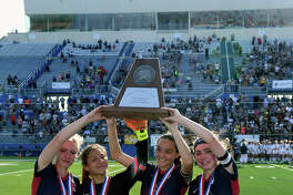Katy Tompkins seniors Katy Reid, from left, Cailey Croson, JpAnnie Ramos and Mikylin York hoist their  team's runner-up trophy after their 2-0 loss to Pflugerrville Hendrickson in the Class 6A Girls Final at the 2017 UIL Soccer State Championships at Birkelbach Field in Georgetown on Saturday, April 15, 2017. (Photo by Jerry Baker/Freelance)