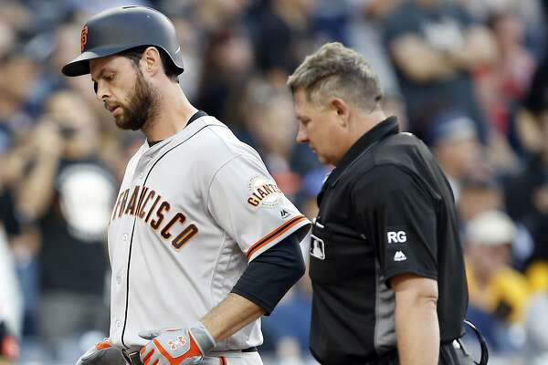 Home plate umpire Greg Gibson, right, makes sure San Francisco Giants Brandon Belt touches the plate after hitting a solo home run during the eighth inning of the Giants' baseball game against the San Diego Padres in San Diego, Friday, April 7, 2017. (AP Photo/Alex Gallardo)
