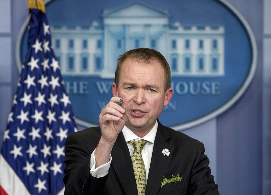 In this March 16, 2017, file photo, White House budget director Mick Mulvaney speaks at the White House, in Washington. Mulvaney says that Democratic negotiators on a massive spending bill need to agree to funding top priorities of President Donald Trump, such as a down payment on a border wall and hiring of additional immigration agents.Click through this slideshow to see renderings for Trump's proposed border wall. Photo: Andrew Harnik, Associated Press