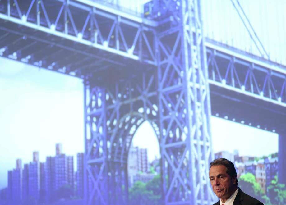 New York Gov. Andrew Cuomo speaks about infrastructure projects while an image of the George Washington Bridge is projected behind him in New York, Wednesday, Oct. 5, 2016. Cuomo announced that the city's first bridge light show will be held Thursday, April 27, 2017 on the new Kosciusko bridge between Queens and Brooklyn - lighting that will include the George Washington bridge and all MTA bridges and tunnels in New York City by May 2018.  (AP Photo/Seth Wenig) ORG XMIT: NYSW112 Photo: Seth Wenig / Copyright 2016 The Associated Press. All rights reserved.
