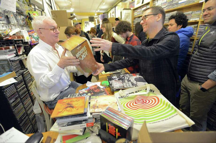 "Owner John Konrad attempts to convince Wes Siegal of Stamford that he must own ""House of Joy"", a box set packed with rare Studio One singles and a lot of other joyful things, during Record Store Day at Johnny's Records in Darien, Conn. on Saturday, April 21, 2017. Record Store Day is an international annual event to ""celebrate the culture of the independently owned record stores, bringing together fans, artists, and thousands of independent record stores across the world. A number of records are pressed specifically for Record Store Day, with a unique list of special-edition releases from Prince, David Bowie, The Beatles and more making 2017's Record Store Day one of the most-anticipated in years. Photo: Matthew Brown / Hearst Connecticut Media / Stamford Advocate"
