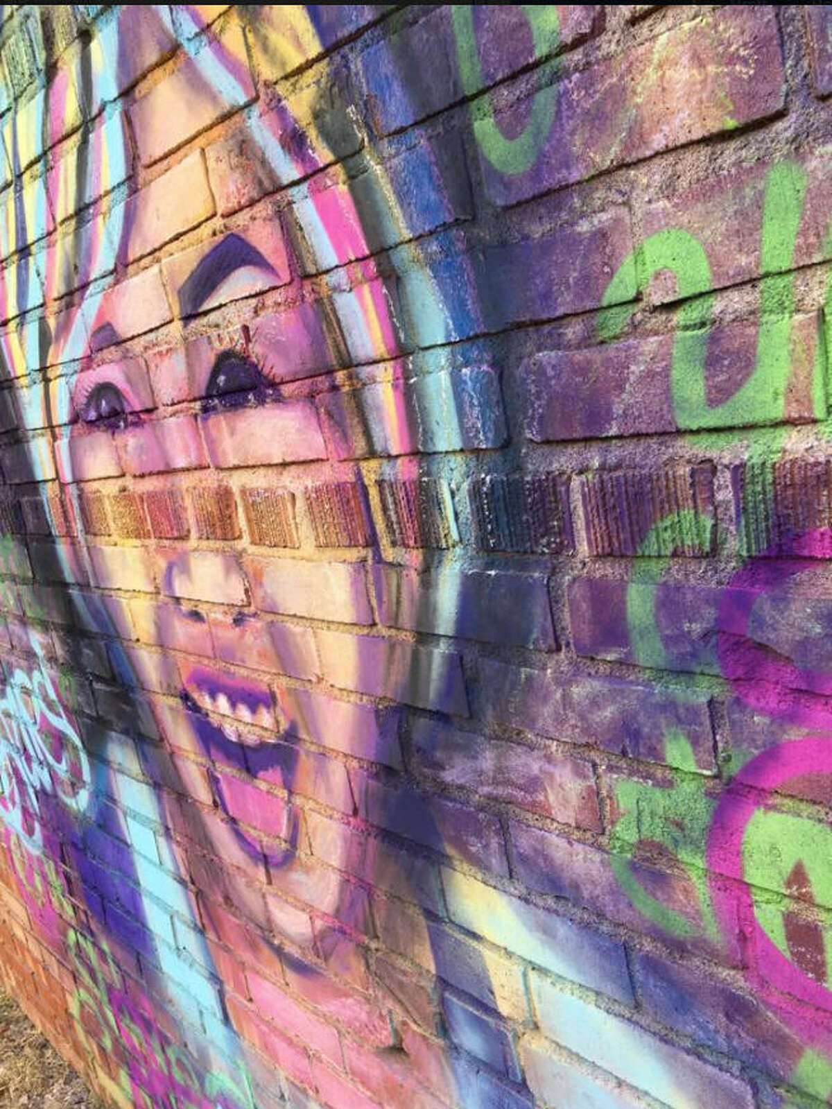 An artist from El Paso traveled to Alpine on Saturday, April 22, 2017, and painted a temporary mural honoring slain college student ZuZu Verk on the side of a record store. Verk, whose remains were found in February, would have been 23. Scroll through the gallery to see a timeline of the disappearance of ZuZu Verk