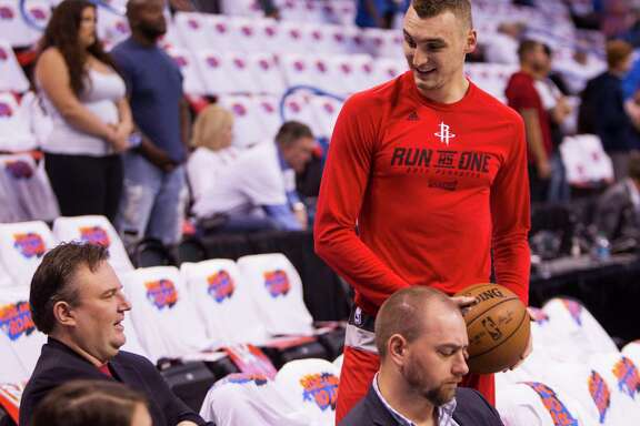 Houston Rockets forward Sam Dekker, right, talks to general manager Darryl Morey before Game 4 of the NBA Western Conference first-round playoff series at Chesapeake Energy Arena on Sunday, April 23, 2017, in Oklahoma City.