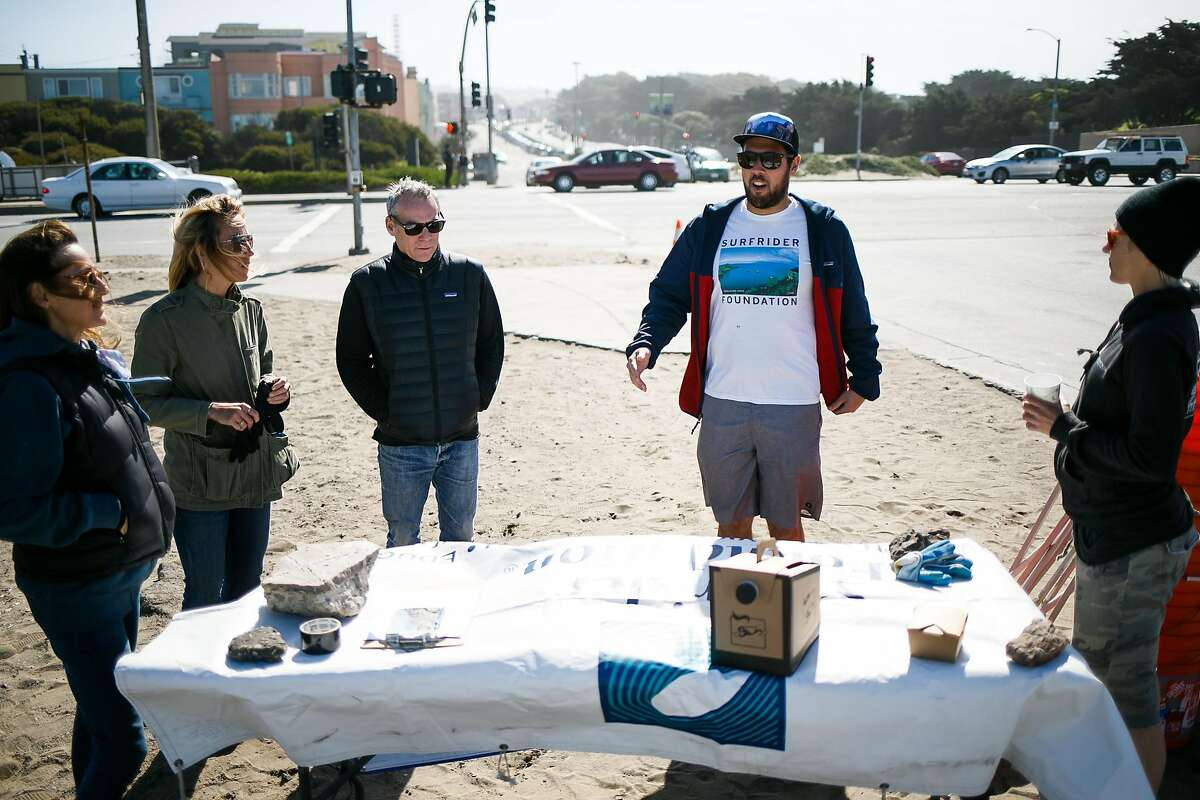 Chair of the Surfrider Foundation San Francisco chapter, Max Ernst, center right, talks to volunteers before the start of the Surfrider Foundation's annual beach clean-up event at Ocean Beach in San Francisco, Calif. Sunday, April 23, 2017.