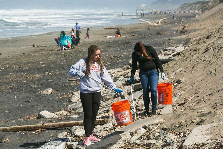 Lauren Mungo and Victoria Gonzalez of the John Muir Health chapter of HOSA pick trash during the Surfrider Foundation's annual beach clean-up event at Ocean Beach in San Francisco, Calif. Sunday, April 23, 2017.