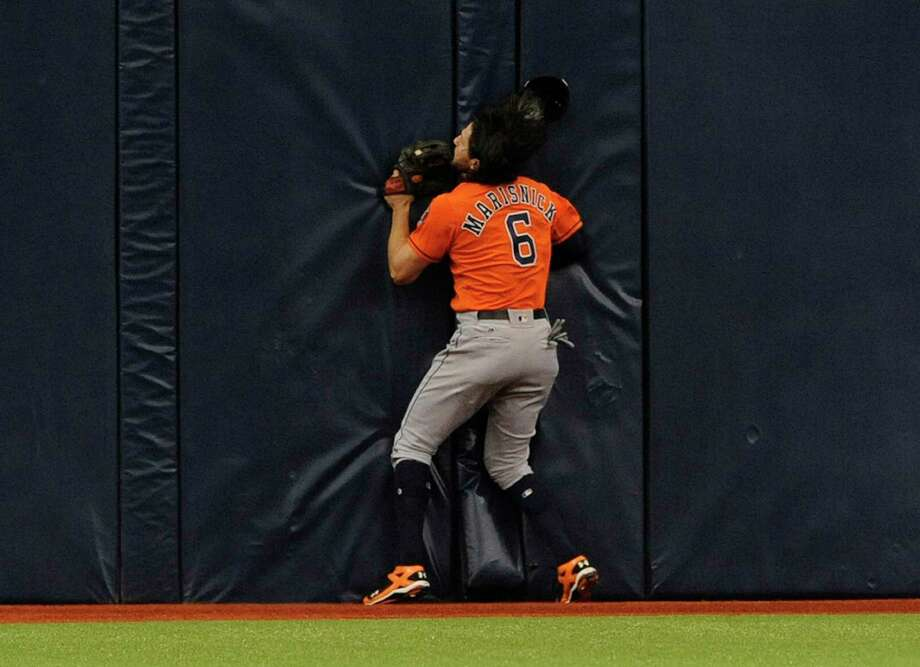 Houston Astros center fielder Jake Marisnick hits the wall after catching a fly ball to the warning track hit by Tampa Bay Rays' Logan Morrison during the first inning of a baseball game Sunday, April 23, 2017, in St. Petersburg, Fla. (AP Photo/Steve Nesius) Photo: Steve Nesius, Associated Press / FR69810 AP