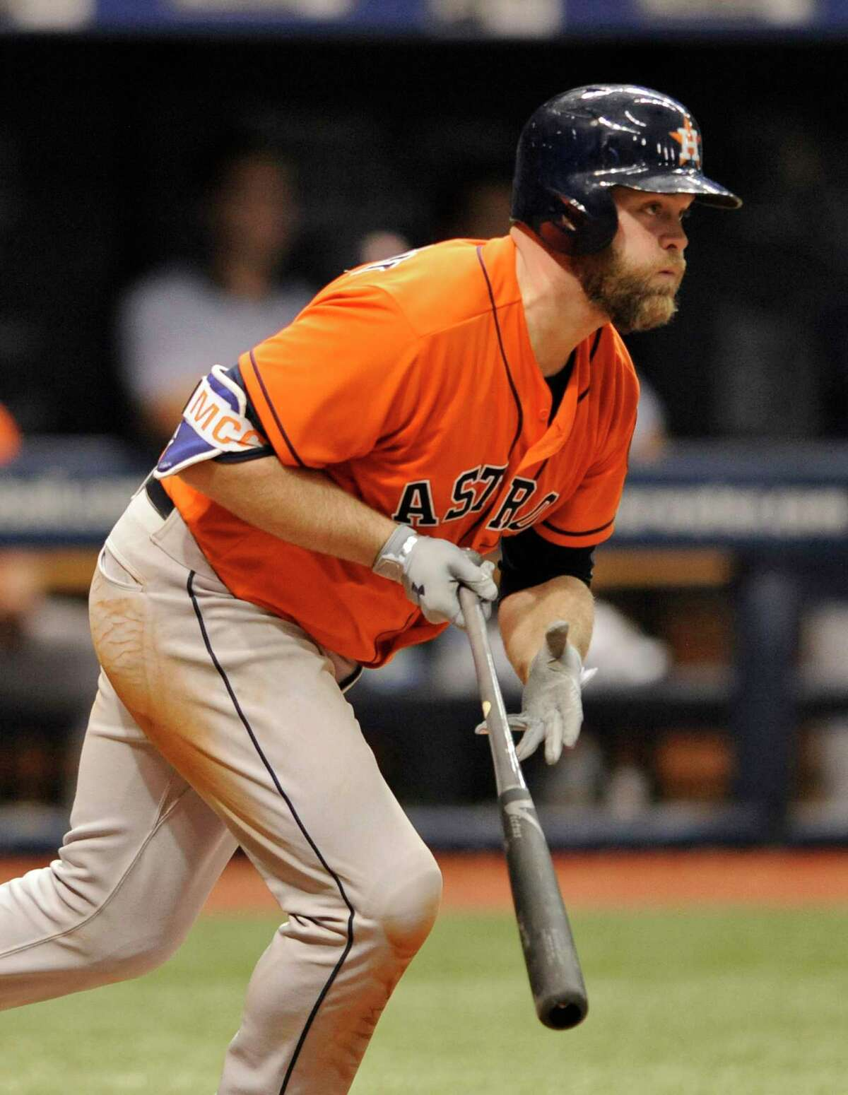 Houston Astros' Brian McCann hits an RBI-single off Tampa Bay Rays reliever Ryan Garton during the 10th inning of a baseball game, Sunday, April 23, 2017, in St. Petersburg, Fla. (AP Photo/Steve Nesius)