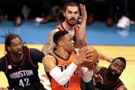 Oklahoma City Thunder guard Russell Westbrook (0) goes up for a shot over Houston Rockets guard James Harden (13) during the first quarter of Game 4 of the NBA Western Conference first-round playoff series at Chesapeake Energy Arena on Sunday, April 23, 2017, in Oklahoma City.