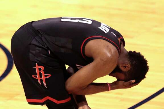 Houston Rockets guard James Harden (13) holds his head after driving the basket against the Oklahoma City Thunder during the first quarter of Game 4 of the NBA Western Conference first-round playoff series at Chesapeake Energy Arena on Sunday, April 23, 2017, in Oklahoma City.